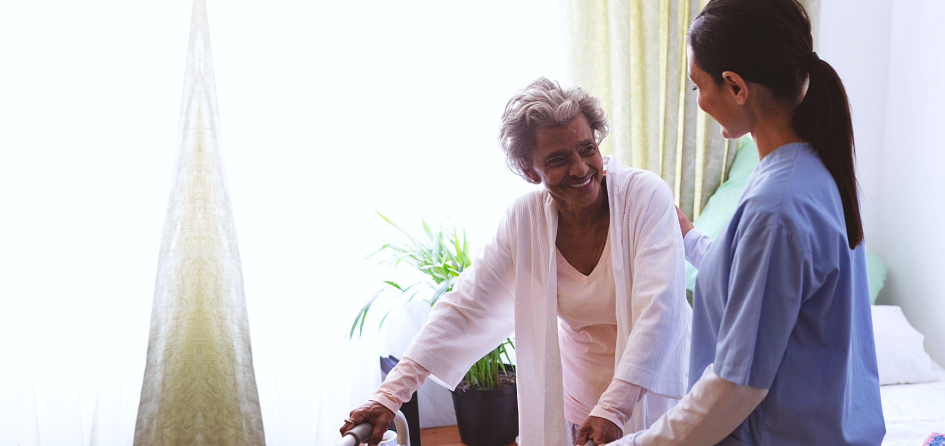 caregiver helping a senior woman
