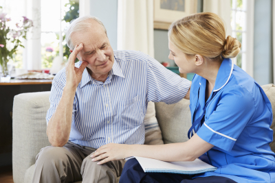 nurse visits senior man at home