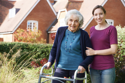 caregiver helping her senior patient