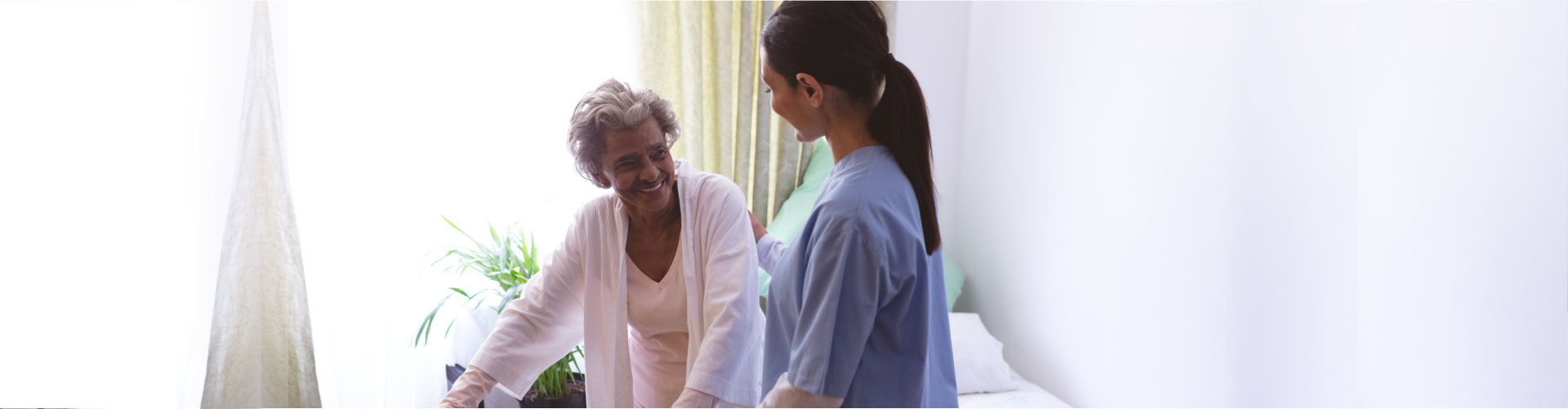 caregiver smiling with her senior patient