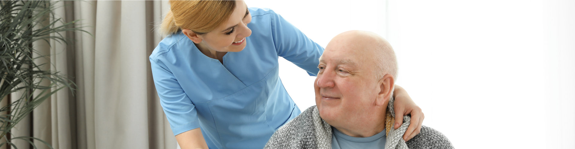 caregiver smiling with her senior patient